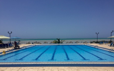 outdoor pool with the Red Sea in the distance